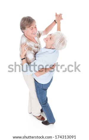 Portrait Of Happy Senior Couple Dancing Over White Background. - stock photo