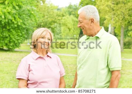 Portrait of happy senior couple outdoors. - stock photo