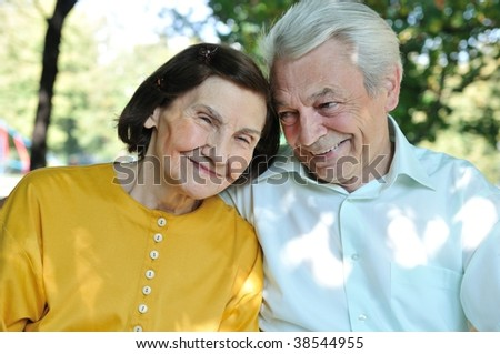 Portrait of happy senior man and woman outdoors in park