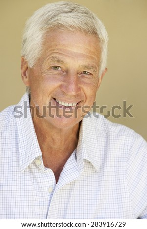 Portrait Of Happy Senior Man At Home