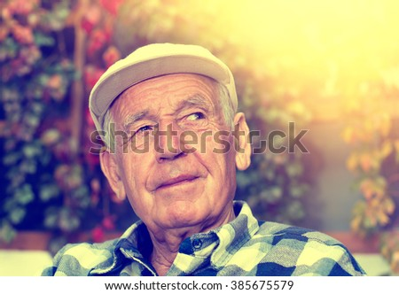 Portrait of  happy senior man smiling and thinking about something nice - stock photo