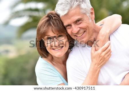 Portrait of happy senior retired couple - stock photo