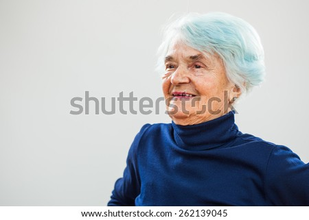 Portrait of happy senior woman  - stock photo