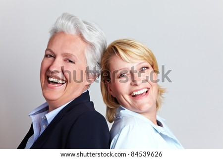Portrait of happy senior woman and her adult daughter - stock photo
