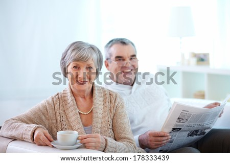 Portrait of happy senior woman and her husband at home - stock photo