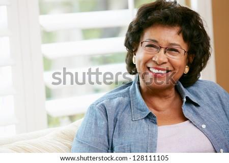Portrait Of Happy Senior Woman At Home - stock photo