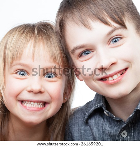 Portrait of happy sister and brother smiling - stock photo