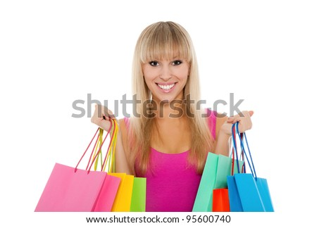 Portrait of happy smile beautiful woman with colorful shopping bags in her hands, girl wear sexy pink dress, isolated over white background
