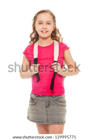 Portrait of happy, smiling and laughing, confident 9 years old girl with curly hair, wearing backpack isolated on white - full height portrait