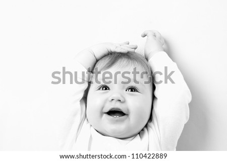 Portrait of happy smiling baby - stock photo