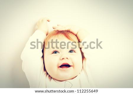 Portrait of happy smiling baby - stock photo
