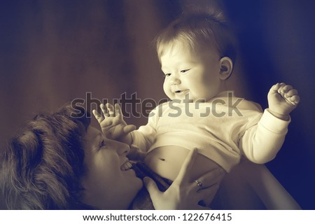 Portrait of happy smiling baby and his mother