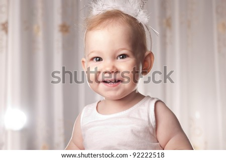 Portrait of happy smiling baby. Flash light to the left. - stock photo