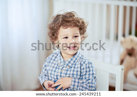 Portrait of happy smiling beautiful boy looking side with his Teddybear in a background - stock photo