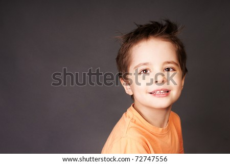 Portrait of happy smiling beautiful little boy, studio shot - stock photo