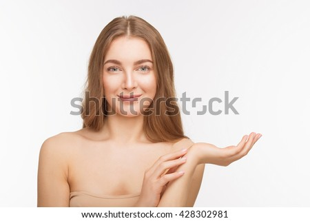 Portrait of happy smiling beautiful shirtless lady holding hand up in front of her over white background in studio. Studio shot. Beauty concept.