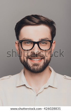 Portrait of happy smiling brainy young guy in spectacles - stock photo