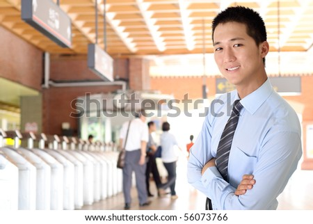 Portrait of happy smiling business man of Asian in station. - stock photo