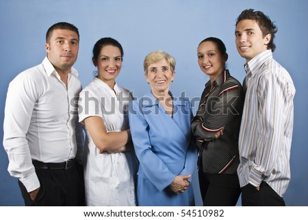Portrait of happy smiling business people group standing in front of image on blue background - stock photo