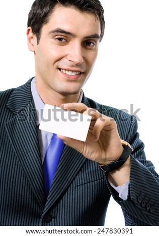 Portrait of happy smiling businessman in blue tie, giving businesscard or bank credit card, isolated against white background - stock photo