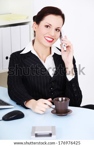 Portrait of happy smiling cheerful beautiful young businesswoman with phone - stock photo