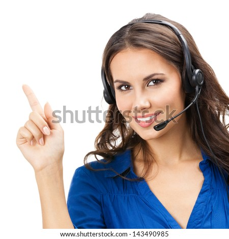 Portrait of happy smiling cheerful beautiful young support phone operator showing, isolated over white background - stock photo