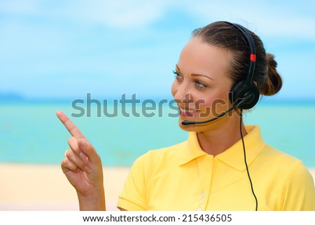 Portrait of happy smiling cheerful beautiful young support phone operator with headset - stock photo
