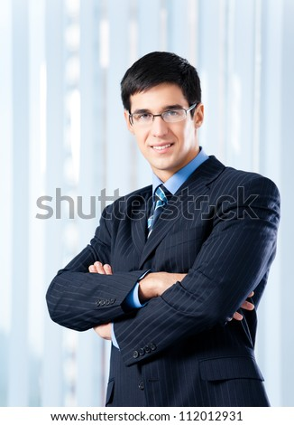 Portrait of happy smiling cheerful business man at office