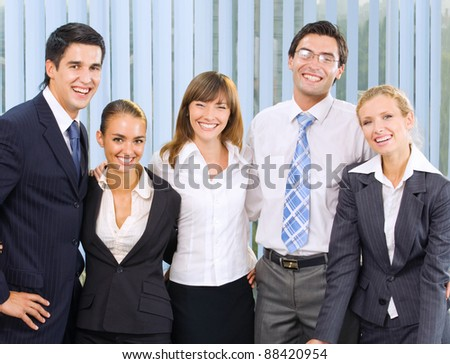 Portrait of happy smiling cheerful business team at office