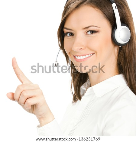 Portrait of happy smiling cheerful customer support phone operator in headset pointing at something, isolated over white background - stock photo