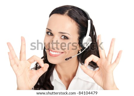 Portrait of happy smiling cheerful customer support phone operator in headset showing okay gesture, isolated on white background - stock photo