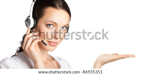 Portrait of happy smiling cheerful customer support phone operator in headset showing something, isolated over white background - stock photo