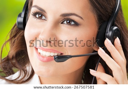 Portrait of happy smiling cheerful young businesswomen, support phone female operator or call center worker, in headset. Help and consulting concept.  - stock photo