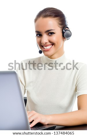Portrait of happy smiling cheerful young customer support phone operator in headset with laptop, isolated over white background - stock photo