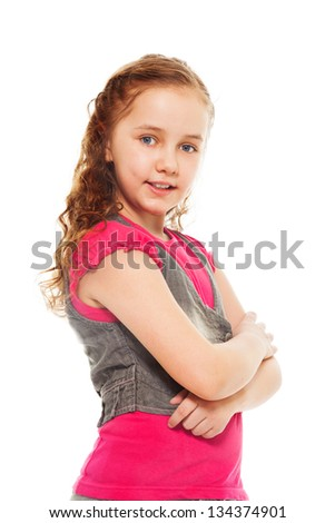 Portrait of happy, smiling, confident 9 years old girl with curly hair, isolated on white - side view - stock photo