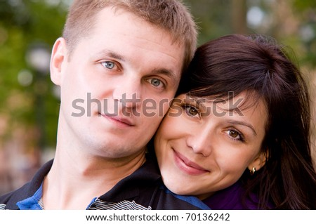 portrait of happy smiling couple looking at camera