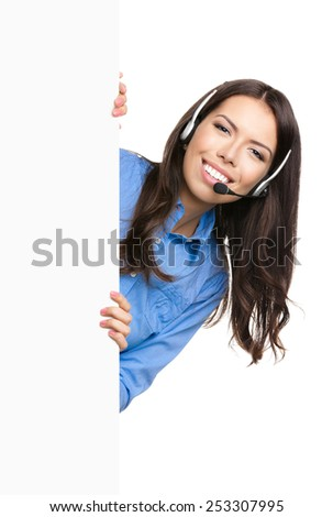Portrait of happy smiling customer support phone operator in headset showing blank signboard with area for copyspace or product, isolated over white background - stock photo