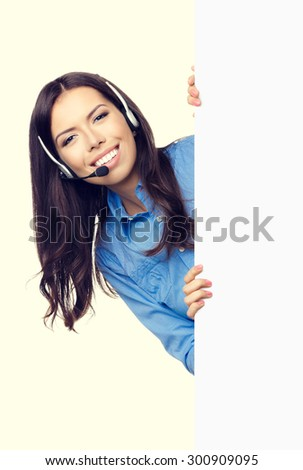 Portrait of happy smiling customer support phone operator in headset showing blank signboard with area for copyspace or product - stock photo