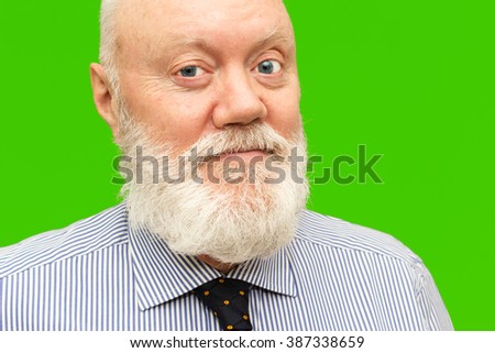 Portrait of happy smiling elderly man posing on green background, color and contrast manipulated - stock photo