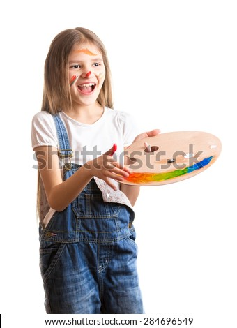 Portrait of happy smiling girl with paint on face posing with color palette - stock photo