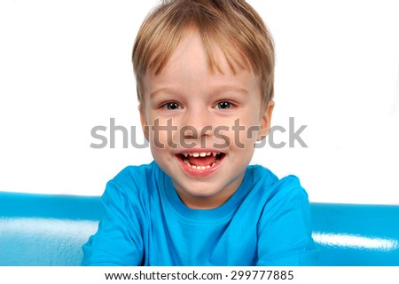 Portrait of happy smiling little boy on white background - stock photo