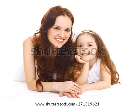 Portrait of happy smiling mother and daughter having fun together  - stock photo