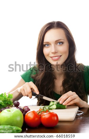 Portrait of happy smiling woman cooking with vegetarian food, isolated on white background