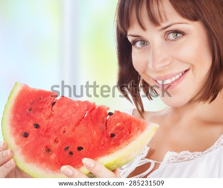 Portrait of happy smiling woman eat fresh red ripe watermelon at home, enjoying summer fruits, organic food, healthy natural dessert - stock photo