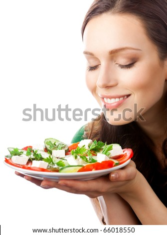 Portrait of happy smiling woman with plate of salad, isolated on white background - stock photo