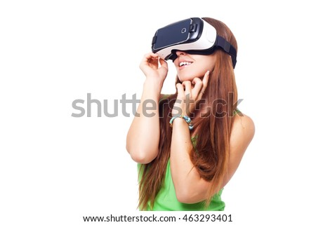 portrait of happy smiling young beautiful girl getting experience using VR-headset glasses of virtual reality isolated