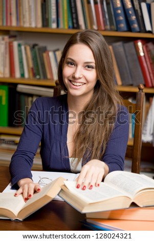 Portrait of happy smiling young brunette student girl. - stock photo
