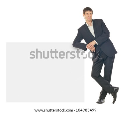 Portrait of happy smiling young business man showing blank signboard, isolated over white background - stock photo