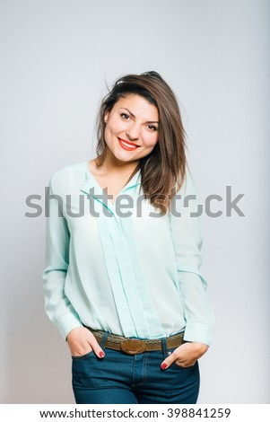 Portrait of happy smiling young business woman .  - stock photo