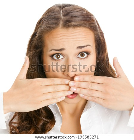 Portrait of happy smiling young business woman covering with hands her mouth, isolated over white background